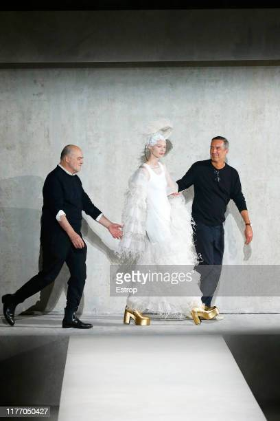A model with Christian Lacroix and Dries Van Noten during the Dries Van Noten Womenswear Spring/Summer 2020 show as part of Paris Fashion Week on...