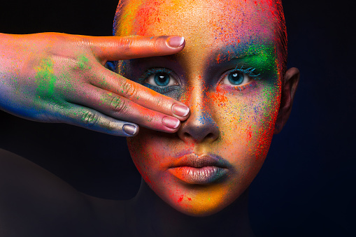 Model with colorful art make-up, close-up 818430052
