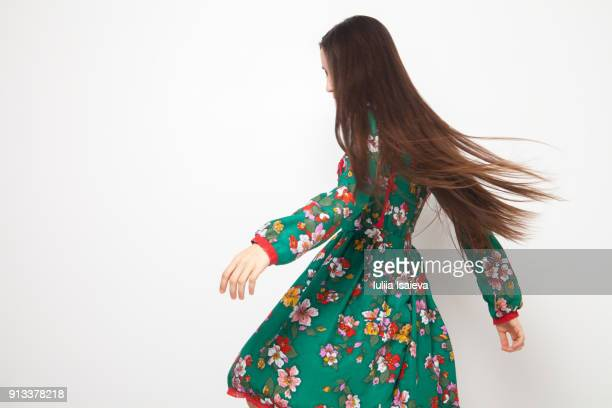 model with long hair spinning around - vestido de colores fotografías e imágenes de stock