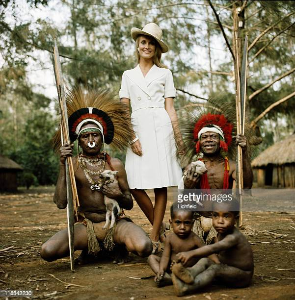 Model with New Guinea Tribesmen New Guinea 1st October 1972