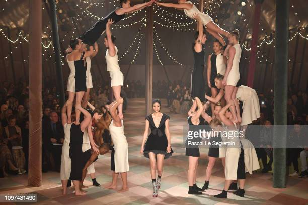 Model with performers on the runway during the Christian Dior Spring Summer 2019 show as part of Paris Fashion Week on January 21, 2019 in Paris,...