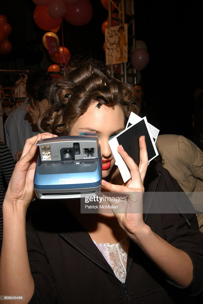 Model with Polaroid camera Backstage at BETSEY JOHNSON Spring 2007 Fashion Show at The Tent at Bryant Park on September 12, 2006 in New York City.
