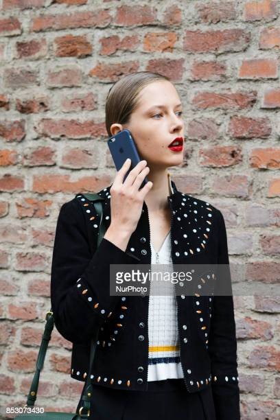 A model with red lipstick and styled hair is seen outside Ermanno Scervino during Milan Fashion Week Spring/Summer 2018 on September 23 2017 in Milan...