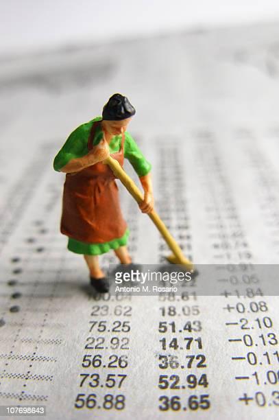 Model woman sweeping financial figures