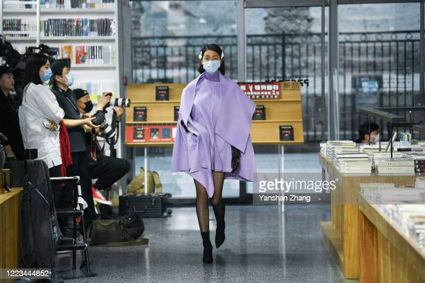 Model works the Larome &DIANA KWAN collection show by Chinese designer Yifan Chen&Yue Guan during the China Fashion Week 2020/2021 A/W Collection on...