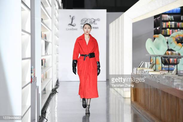 A model works the Larome DIANA KWAN collection show by Chinese designer Yifan ChenYue Guan during the China Fashion Week 2020/2021 A/W Collection on...