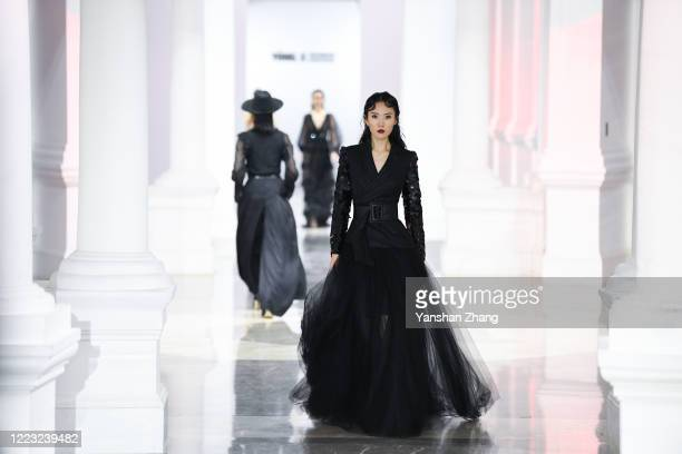 A model works the YONG X collection show by Chinese designer Yong Xing during the China Fashion Week 2020/2021 A/W Collection on May 6 2020 in...