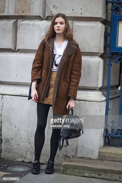 Model Xannie Cater exits the Emilio De La Morena show in an Acne coat and Calvin Klein tshirt during London Fashion Week Fall/Winter 2015/16 at...
