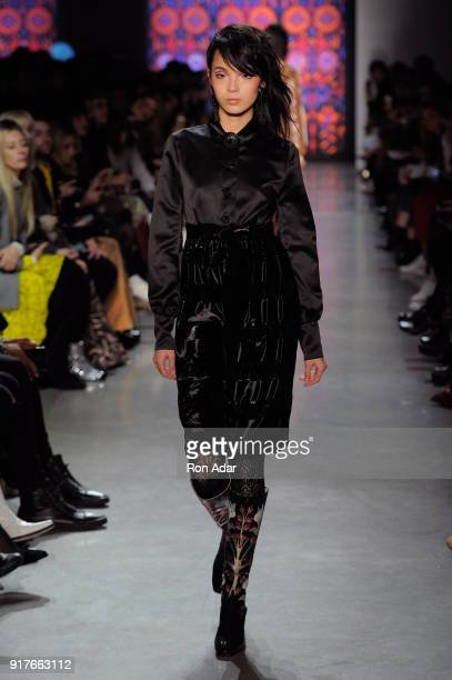 Model Xiao Wen Ju walks the runway for Anna Sui during New York Fashion Week The Shows at Gallery I at Spring Studios on February 12 2018 in New York...