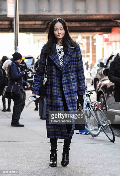 Model Xu is seen outside the Marissa Webb show with an Alexander McQueen bag on February 12 2015 in New York City