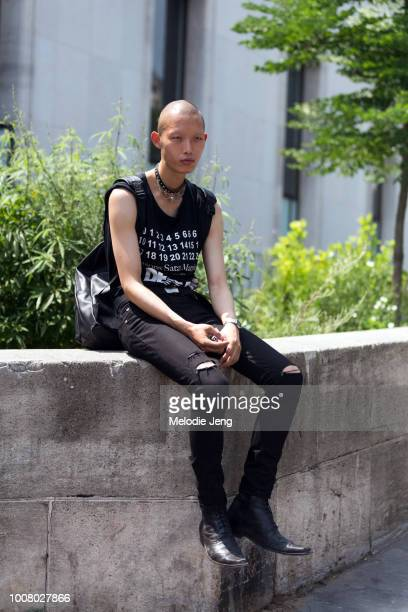 Model Xu Meen wears a black Margiela sleeveless tshirt black skinny jeans and black boots after the Rick Owens show during Paris Fashion Week Men's...