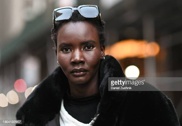 Model Ya Jagne is seen wearing a black coat with sunglasses outside the Christian Siriano show during New York Fashion Week F/W21 on February 25,...