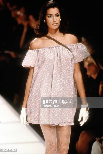 Model Yasmeen Ghauri walks the runway during Armani Fashion show at Milan Fashion Week circa 1992 in Milan.
