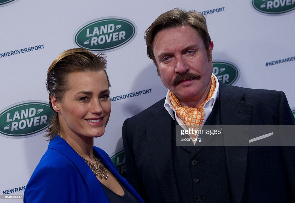 Model Yasmin Le Bon, left, and musician Simon Le Bon pose for a photograph during the unveiling of the Range Rover Sport vehicle, produced by Tata Motors Ltd.'s Jaguar Land Rover unit, in New York, U.S., on Tuesday, March 26, 2013. The Range Rover Sport, the brand's fastest of the line, is the third model introduced in two years, joining the 2013 Range Rover and the Range Rover Evoque. Photographer: Jin Lee/Bloomberg via Getty Images