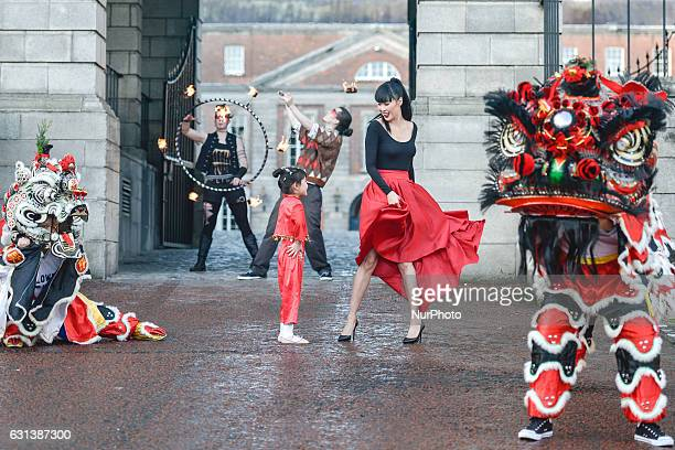 Model Yomiko Chen poses with a Chinese Lion and Unicorn mesmerising fire breathers and talented children from the Chinese community at the launch of...