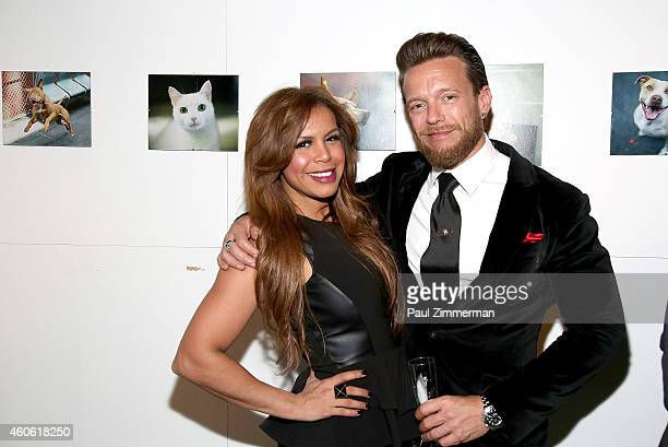 Model Yorkanis Francis and photographer Jamie McCarthy attend a pet portrait exhibition by Getty Images staff photographer Jamie McCarthy to benefit...
