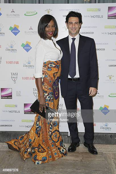 Model Youma and Fabrizio Ragone attend the Children for Peace Benifit Gala red carpet at Spazio Novecento on November 28 2014 in Rome Italy