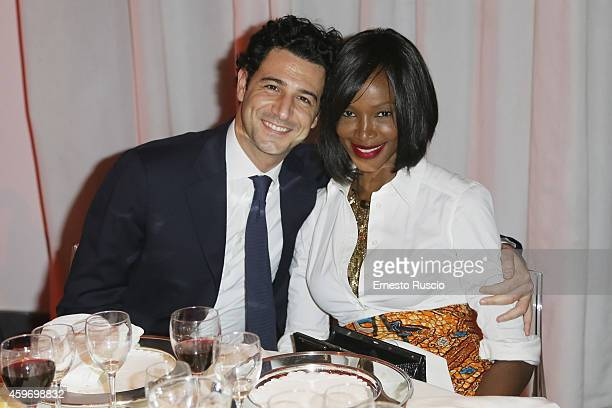 Model Youma and Fabrizio Ragone pose during the Children for Peace Benifit Gala red carpet at Spazio Novecento on November 28 2014 in Rome Italy