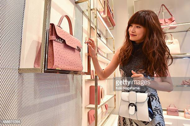 Model Youna attends the Delvaux Red Moon Party at Delvaux Omotesando on November 7 2014 in Tokyo Japan