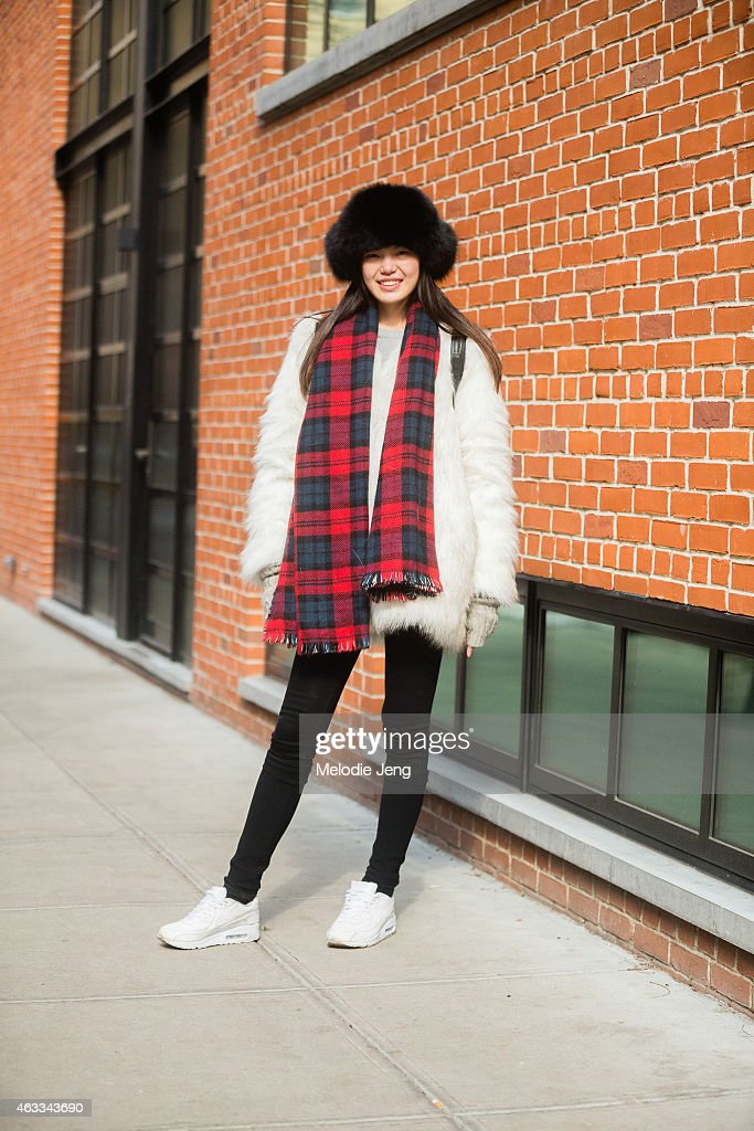 Model Yu Du wears a jacket and hat from China, Alexander Wang bag, and Nike shoes at Streets of Manhattan on February 12, 2015 in New York City.