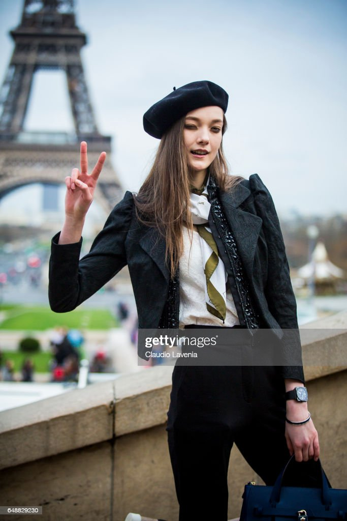 Model Yumi Lambert is seen in front of the Eiffel tower after the Hermes show during Paris Fashion Week Womenswear Fall/Winter 2017/2018 on March 6, 2017 in Paris, France.