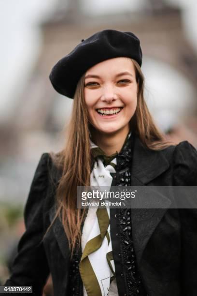 Model Yumi Lambert wears a black beret hat outside the Hermes show during Paris Fashion Week Womenswear Fall/Winter 2017/2018 on March 6 2017 in...