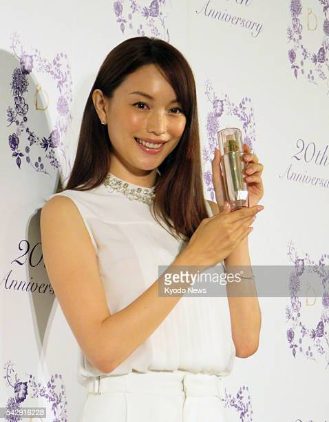 Model Yuri Ebihara holds a bottle of the Hydro Genius serum a new product of Japanese cosmetics maker Shiseido Co at a press conference in Tokyo on...