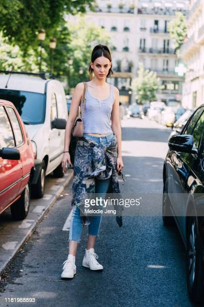 Model Yvonne Bevanda wears a gray tank top, tie-dye shirt tied around her waist, cropped jeans, and white Converse sneakers after the Jean Paul...
