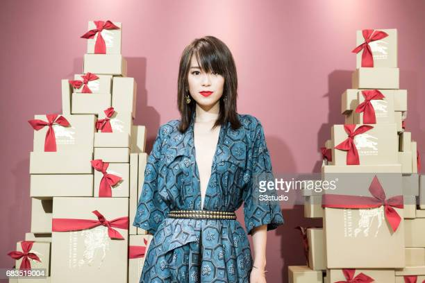 Model Zelia Zhong poses for a photograph on the red carpet at the Burberry Pacific Place event on 03 November 2016 in Hong Kong, China.