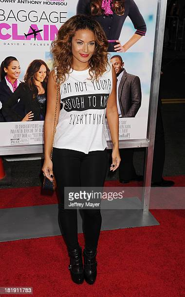 Model Zena Foster arrives at the Los Angeles premiere of 'Baggage Claim' at Regal Cinemas LA Live on September 25 2013 in Los Angeles California