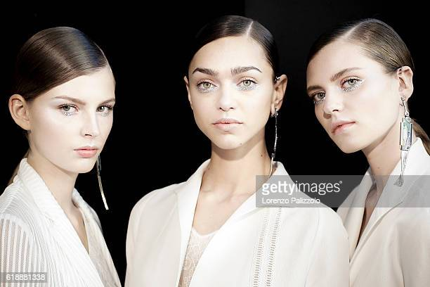 Model Zhenya Katava and models pose prior the Shiatzy Chen show as part of the Paris Fashion Week Womenswear Spring/Summer 2017 on October 4 2016 in...