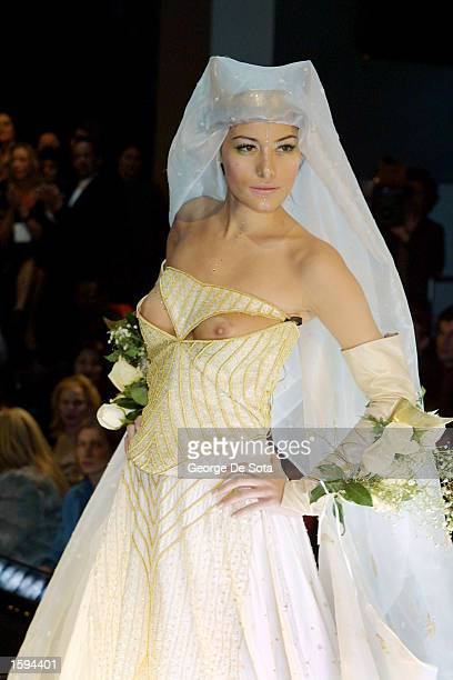 Model Zita wears a wedding gown as she walks down the runway during the Anand Jon Fall/Winter 2001 fashion show February 14 2001 at the WWF...