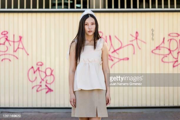 Model Ziyi Yang wears Onlycolorlife diadem Nadezna top Valdivia's Vintage skirt and Lobo shoes on June 20 2020 in Madrid Spain