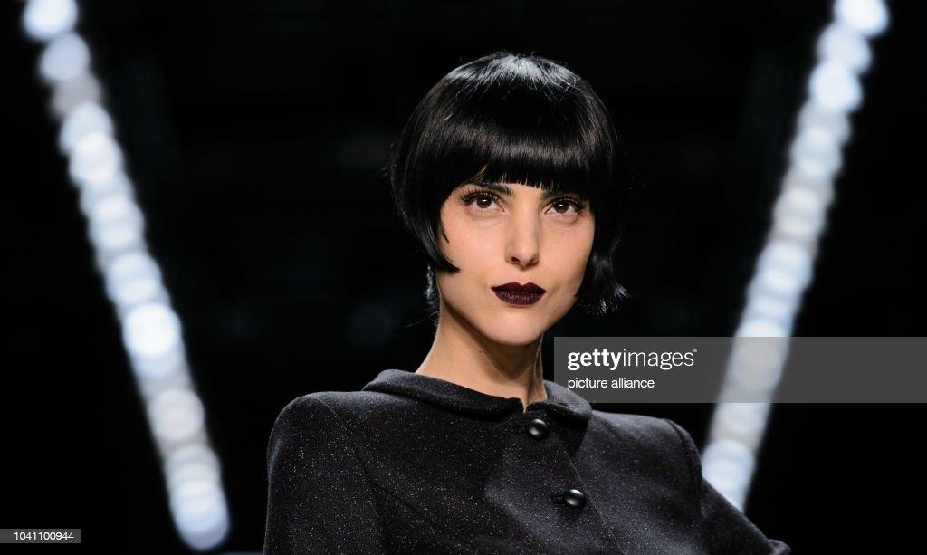 Model Zoe Helali presents a creation by Guido Maria Kretschmer at the  Mercedes-Benz Fashion b2a9aae4e1