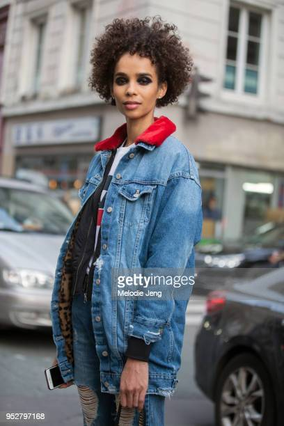 Model Zuleica Eliana wears a denim jacket and black eyemakeup after the Jean Paul Gaultier show on January 24, 2018 in Paris, France.