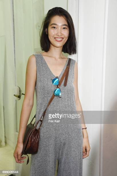 Model Zupan Guo UX/UI Web designer attends Ken Okada Yellow Carpet Street Show Rue de La Chaise As Part of Faubourg Saint Germain Neighbours Picnic...