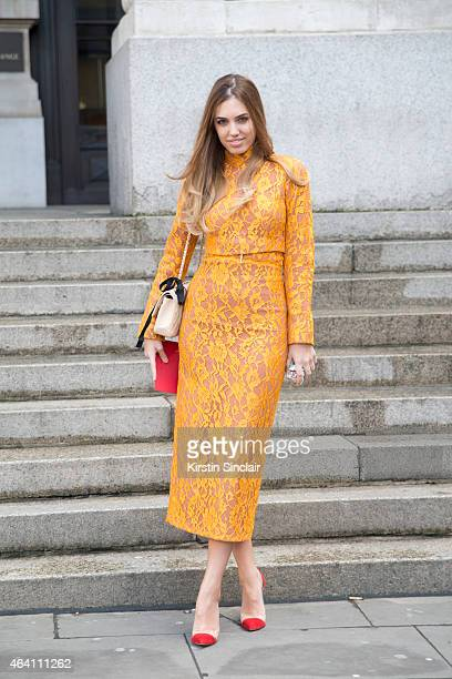 Modela and DJ Amber Le Bon wears an Emilia Wickstead dress Chanel bag and Gianvitto Rossi shoes on February 21 2015 in London England