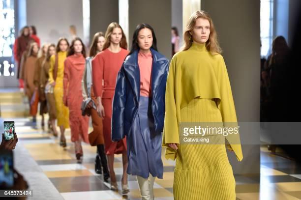Modela walk the runway at the Jil Sander Autumn Winter 2017 fashion show during Milan Fashion Week on February 25, 2017 in Milan, Italy.