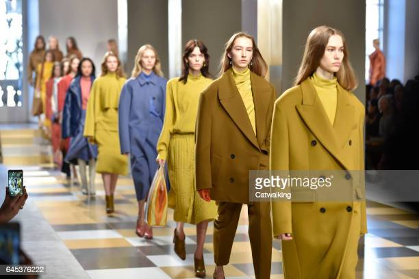 Modela walk the runway at the Jil Sander Autumn Winter 2017 fashion show during Milan Fashion Week on February 25 2017 in Milan Italy