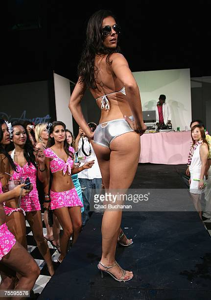 Model/Actress Adrianne Curry walks down the catwalk at the HER Luau at The Playboy Mansion on July 21 2007 in Holmby Hills California