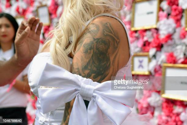 Model/actress Amber Rose tattoo detail attends the 4th Annual Amber Rose SlutWalk on October 6 2018 in Los Angeles California