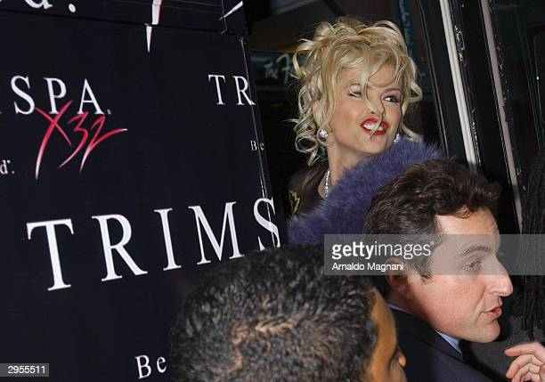 Model/actress Anna Nicole Smith climbs aboard her TrimSpa bus after attending the Betsey Johnson Fashion Show February 9 2004 in New York City