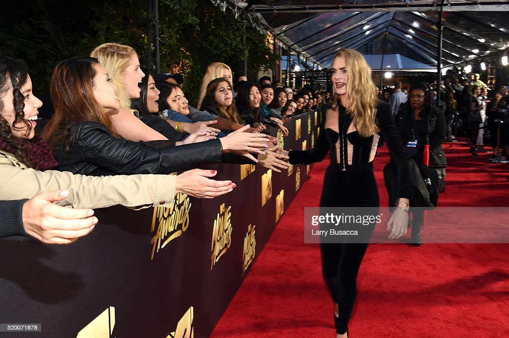 Model/actress Cara Delevingne attends the 2016 MTV Movie Awards at Warner Bros. Studios on April 9, 2016 in Burbank, California. MTV Movie Awards airs April 10, 2016 at 8pm ET/PT.