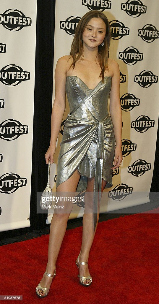 Model/actress Devon Aoki attends the opening night gala of 'Outfest 2004: The 22nd L.A. Gay and Lesbian Film Festival' on July 8, 2004 at the Orpheum Theatre, in Los Angeles, California.