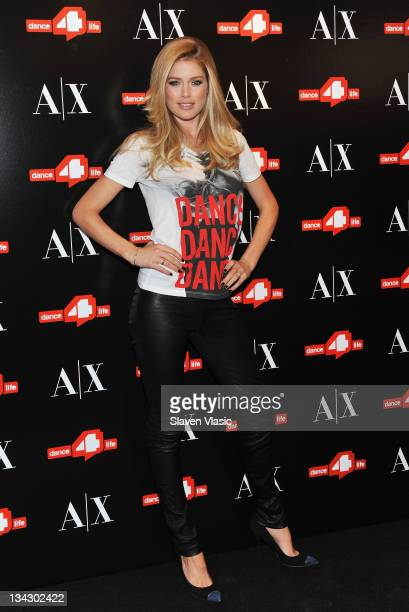 Model/actress Doutzen Kroes unveils the Dance4life Tshirt in honor of World AIDS Day at A|X Armani Exchange Soho on November 30 2011 in New York City