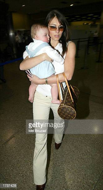 Model/actress Elizabeth Hurley arrives at Los Angeles International Airport with her son Damian on January 21 2003 in Los Angeles California