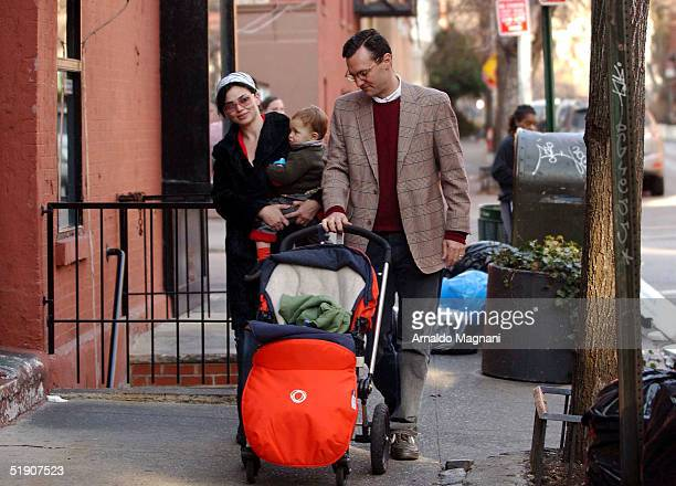 Model/Actress Karen Duffy walks in SoHo with husband John Lambros and son John Augustine January 1 2004 in New York City