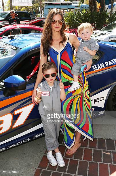 Model/Actress Lauren Michelle Hill and her children attend the 42nd Toyota Grand Prix of Long Beach on April 16 2016 in Long Beach California