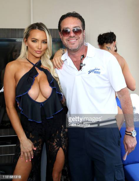 Model/actress Lindsey Pelas and Director of Beverage Operations for Sapphire Gentlemen's Club David Wachs attend a pool party hosted by Pelas at the...
