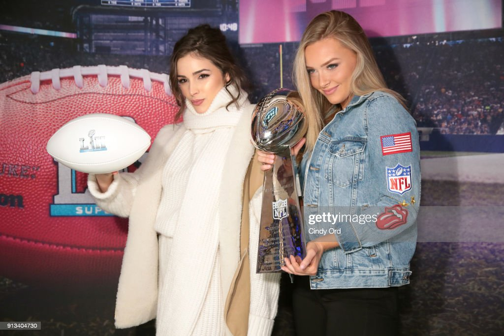 Model/Actress Olivia Culpo (L) and model Camille Kostek attend SiriusXM at Super Bowl LII Radio Row at the Mall of America on February 2, 2018 in Bloomington, Minnesota.